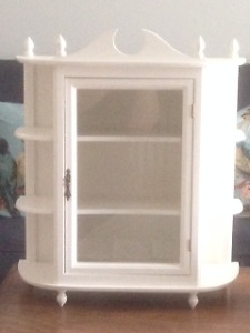 White curio cabinet with glass door.Reduced. Was $25. Now $20