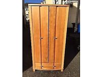 Sturdy pine double wardrobe with base drawer