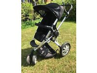 A Quinny Buzz pushchair and accessories