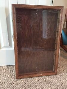"Oak Curio cabinet with 9 X 1"" adjustable glass shelves"