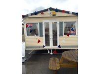 static caravan sited on st osyth holiday park essex double glazed gas heated.direct beach access