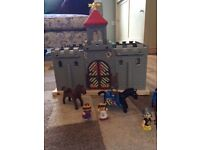 Toy castle, knights and horses