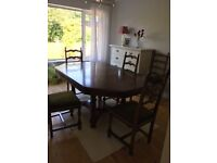 Dining table and 4 chairs in Walnut - traditional style in very good condition