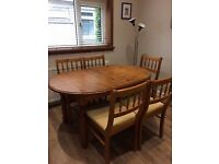 Solid wood dining table and 6 chairs. Table extends.