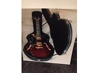 Epiphone Les Paul Custom guitar - left hand, black with hard case. As new- played once or twice .