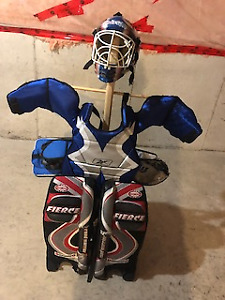 Road hockey helmet,chest protector and equipment stand