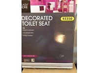New still in box decorated toilet seat