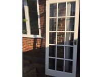 9 used solid wood glazed doors all with brass effect handles plus latches and hinges