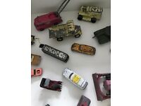 Box of toy cars, farm, and emergency service vehicles.