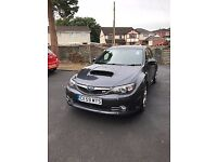 2.5 WRX STI 330S 5 door hatchback gunmetal grey.