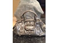 Guess genuine silver ladies handbag with chrome buckle and studs