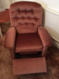 Pink reclining armchairs.