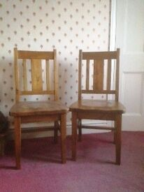 Pair of solid oak dining chairs, made from recycled oak
