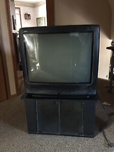 27in RCA CRT Television with remote and heavy duty stand.