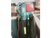 garden vac/blower, with harness ,with wheel on bottom as new 25ono