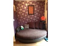 Brown cuddler sofa
