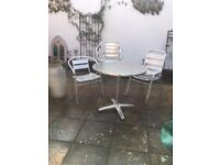 aluminium bistro set table and four chairs plus 2 extra chairs