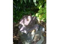 Purple/blue slate pyramid water feature/cascade.