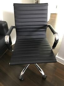 Black office chair in perfect condition and ergonomic