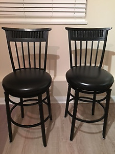 For sale:  2 counter height black padded stools that swivel