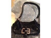Guess Black patent ladies handbag with silver studs
