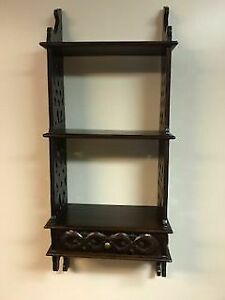 Brown wooden shelf unit for sale
