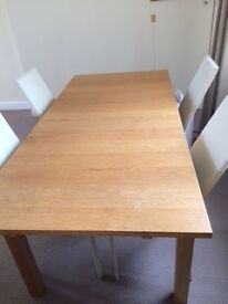 Wooden dining table with cream chairs
