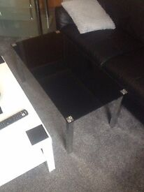 black coffee table and glass tv unit