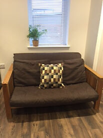 Two seater solid oak sofa bed- Excellent condition