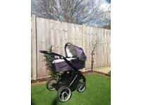 MUTSY EVO STROLLER WITH CARRYCOT, BUGGY BOARD, PARASOL AND 2 RAINCOVERS