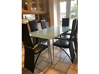 Glass Dining Table (160x90cm) and 6 Leather Chairs