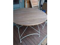 Patio Furniture, round table and four folding chairs.