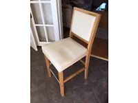 Four nearly new barstools. Cream leather and solid oak legs with backrests.