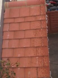 UNUSED over 120 small roof tiles
