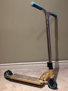 Custom MGP Trick Scooter for sale. (comes with extra parts)