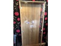 Display Cabinet: Wood and Glass cabinet with 4 glass shelves.