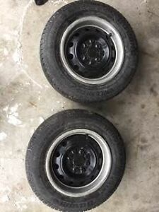 Two 175/70/R13 snow tires and rims