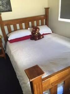 Solid timber queen-sized bed plus two matching bedside tables Wilsonton Toowoomba City Preview