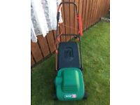 Qualcast Eclipse 320 Rotary Mower with grass box. Folding handle, hardly used. Excellent condition.