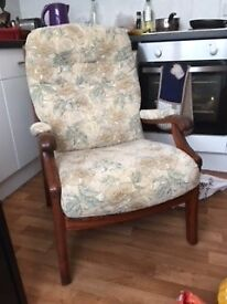 Old fashioned cushioned wooden framed armchair