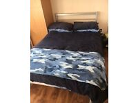 Queen sized steel double bed and mattress
