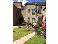 Available now, first floor flat with double bedroom on friendly sheltered development in Huntly
