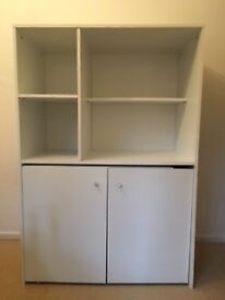 White storage unit with pull out desk