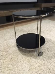 Ikea black glass side table on wheels
