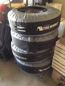 Snow Tires c/w Rims and Covers