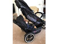 Phil and Ted double pushchair, black and highlight in green. Good condition and includes raincover.