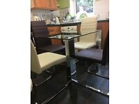 Quality Glass And Chrome Dining Table and 4 Leather Chairs
