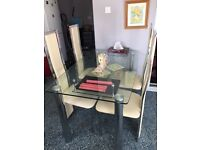 Glass Dining Table & cream chairs (leatherate)