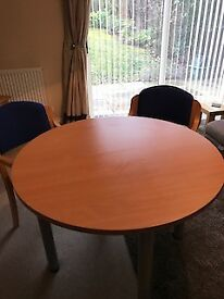 Light tan-coloured, round office table and 2 chairs. - Excellent Condition