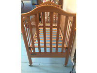 Cossato wooden cot with drop down side